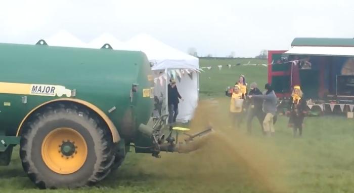 Farmer-spraying-poop