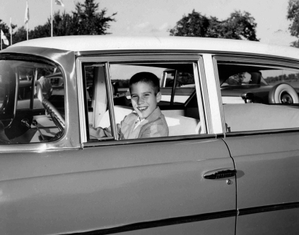 This 1957 photo provided by Romney for President, Inc., shows 10-year-old Mitt Romney in Detroit behind the wheel of a Nash automobile, manufactured by American Motors Corporation of which his father, George Romney, was president. (AP Photo/Courtesy of Romney Family) ** FOR EDITORIAL USE ONLY. NO SALES ** NOT A BLADE PHOTO.