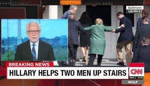 hillary-helping-2-men