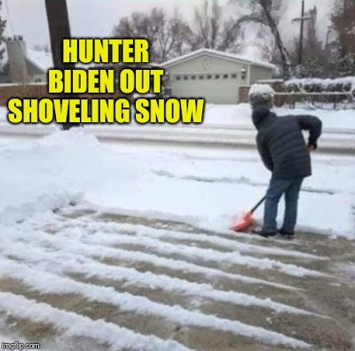Hunter Biden shoveling snow