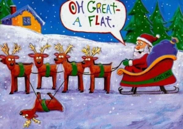 Santa's sleigh has a flat
